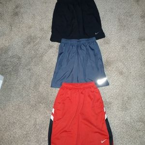 3 pairs of nike dri fit and basketball shorts